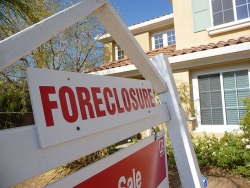 housing market foreclosure sign