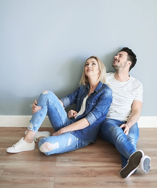 Young couple sitting on wood floor
