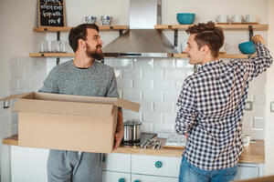 two people unpacking a box