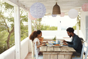 couple eating outside on porch