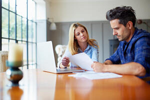 Woman and man reviewing paperwork