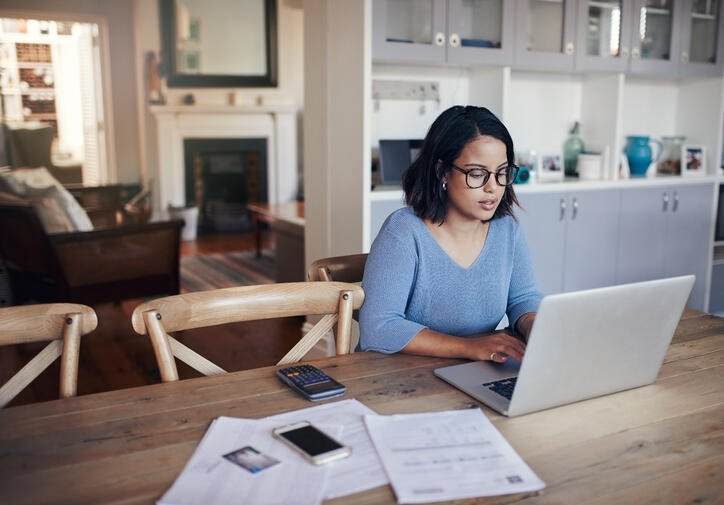 woman at kitchen table on laptop
