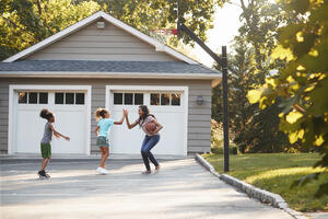 family playing in driveway