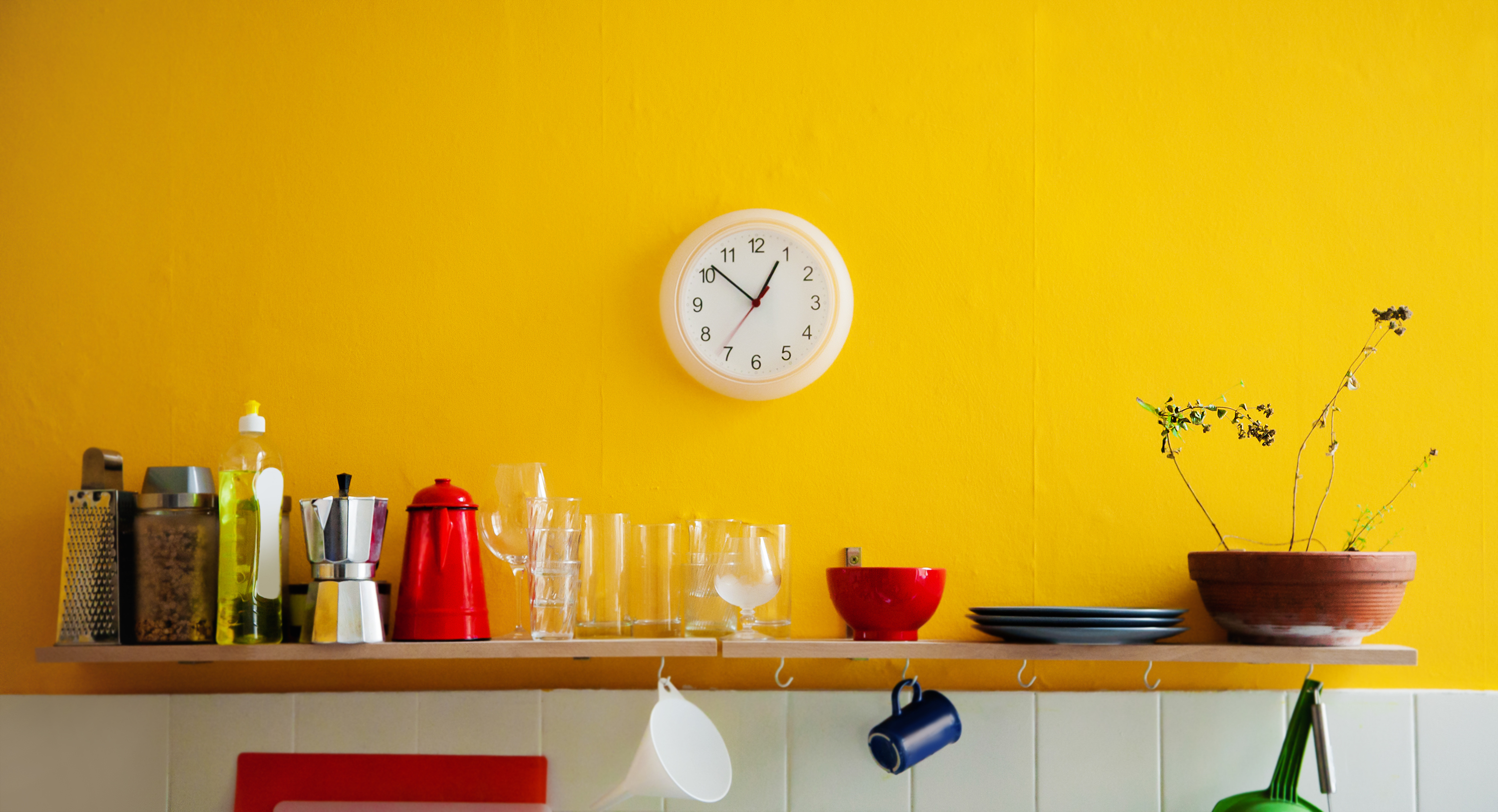 Kitchen with bright yellow wall